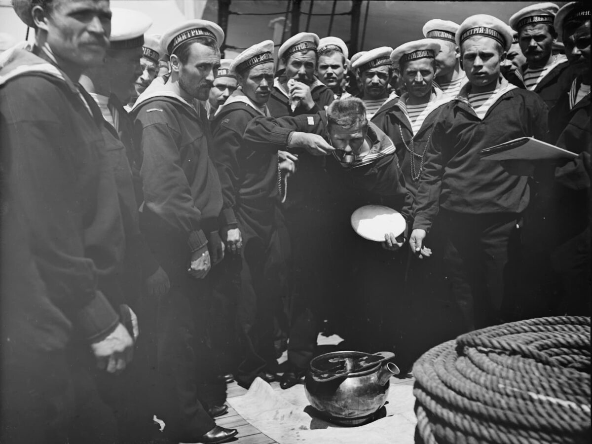 Serving out grog, Russian navy, 1893.